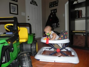 Our lil' guy checks out the BIG tractor