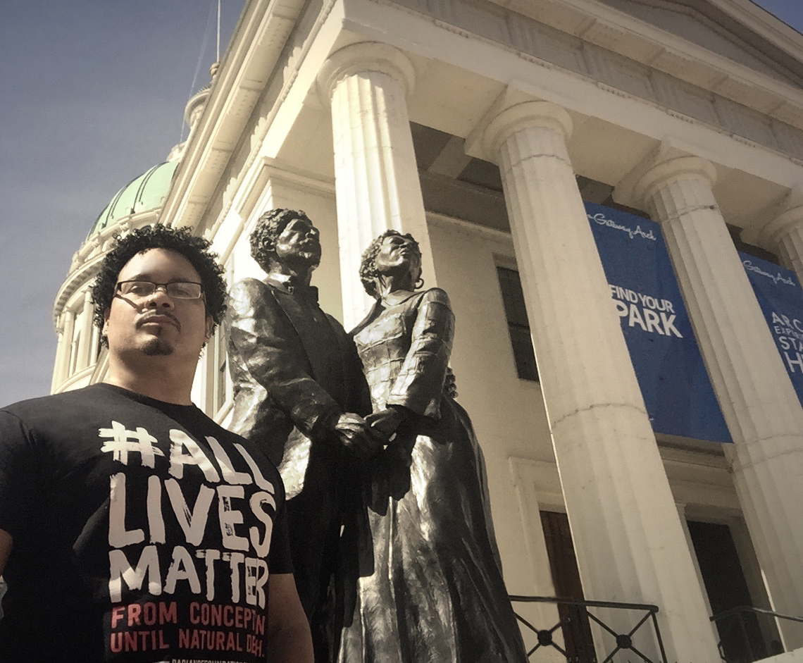 Ryan Bomberger at Harriet and Dred Scott statue at St. Louis Courthouse